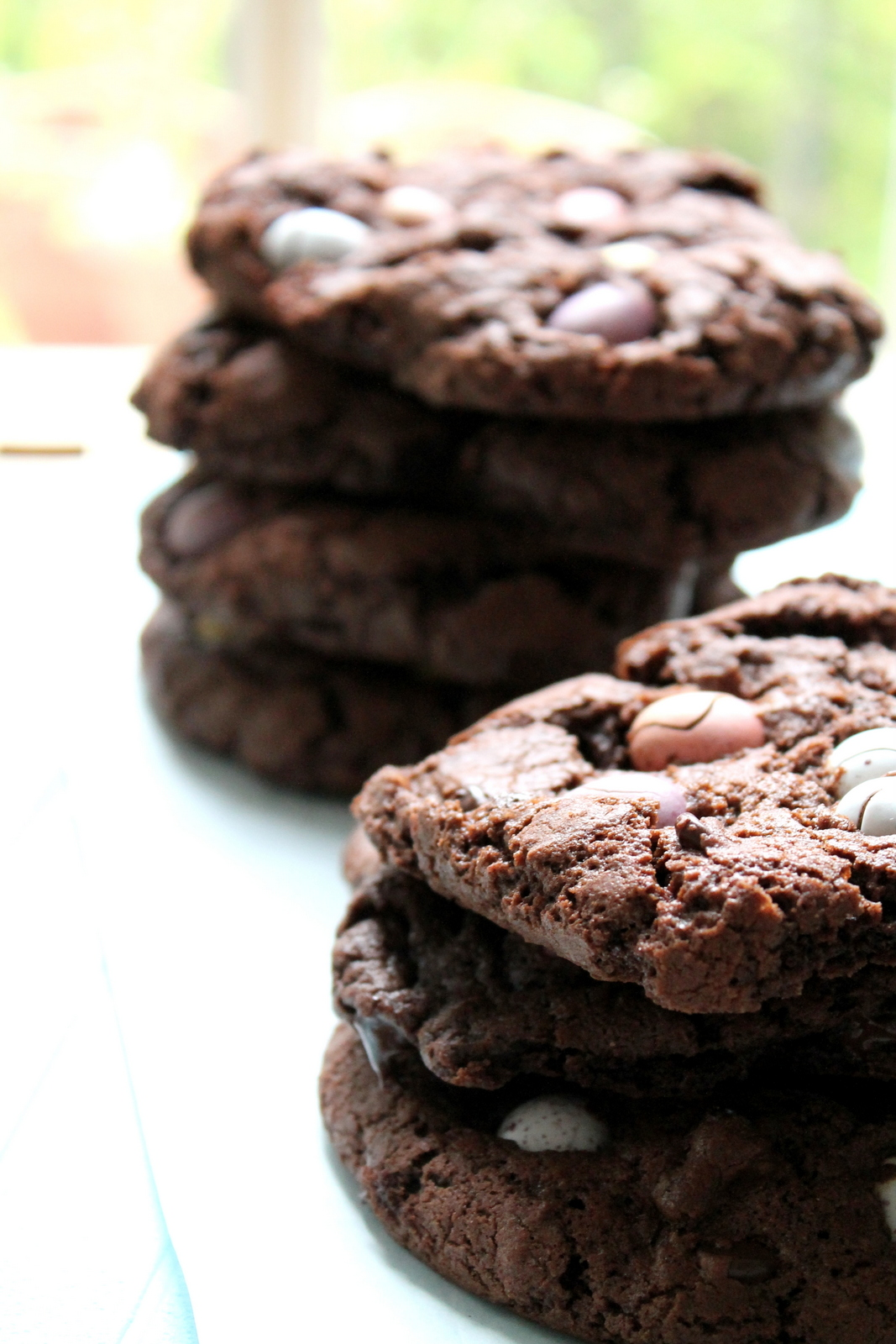 Stacks of dark chocolate cookies with Cadbury's mini eggs