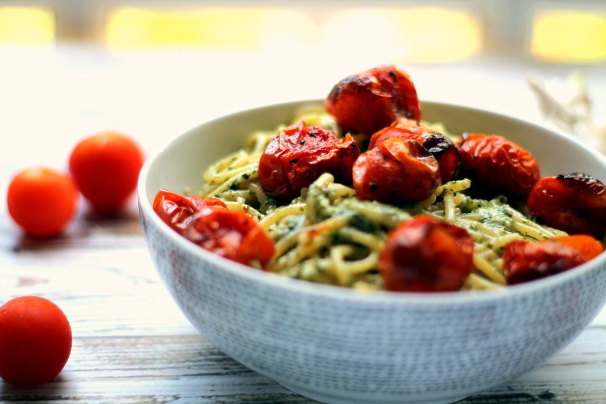 You can't go wrong with a big bowl of pasta with roasted / blistered cherry tomatoes. This recipe uses roasted garlic pesto which is creamy, tasty and naturally vegan. The cherry tomatoes are blistered and intensely flavorful too. You'll be hooked on this simple vegetarian pasta dinner. Best served with a glass of wine!