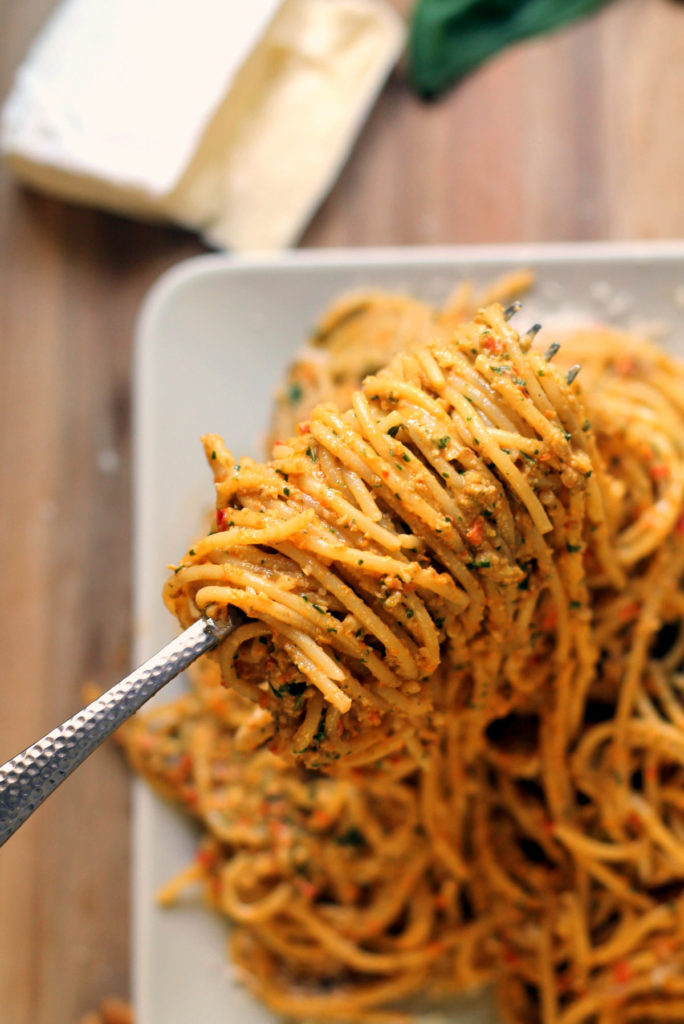 An easy homemade red pepper pesto recipe, with a little something extra! The addition of brie makes this sauce super creamy. Simply stir into cooked pasta, or it would make a great base for a gooey, hearty pasta bake. Scrumptious!