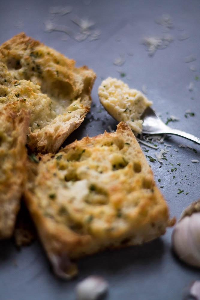 Air fryer garlic bread with focus on the garlic butter