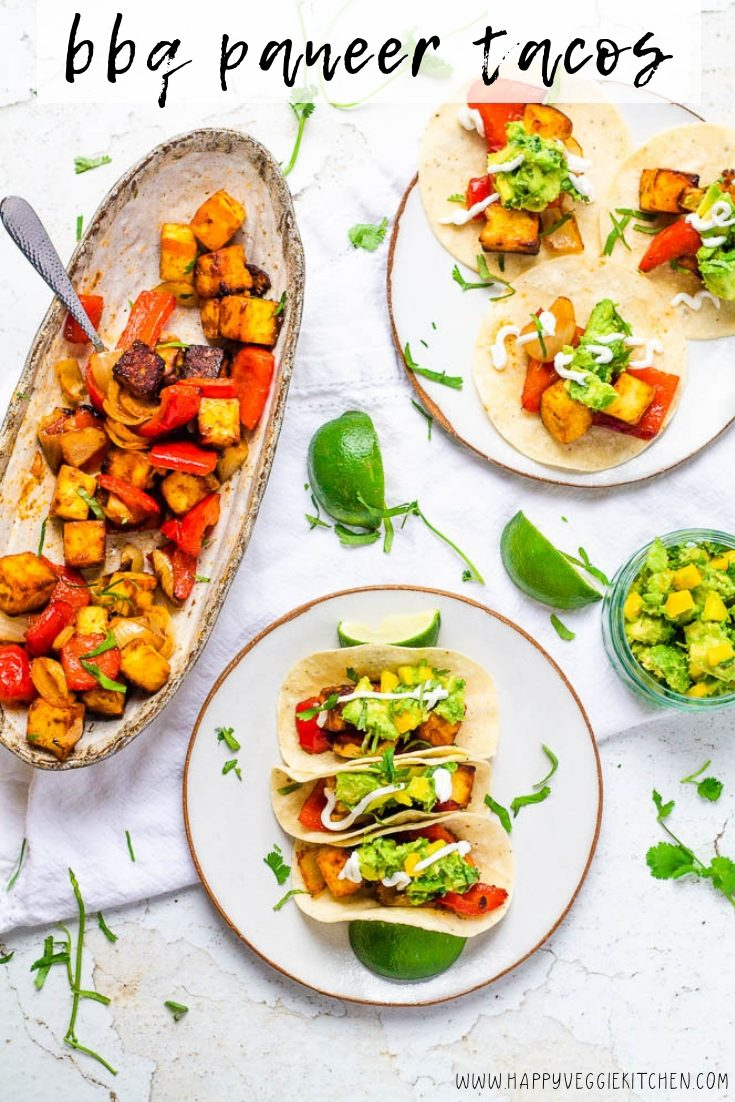 Quick and easy oven roasted BBQ paneer tacos! The Indian cheese paneer makes for an amazing meatless taco filling, roasting beautifully in the oven in a BBQ taco glaze, then topped with an avocado mango salsa. This delicious and unusual fusion meal comes together in just 30 minutes.